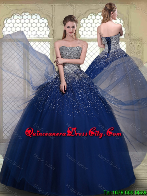 navy blue tulle quinceanera dress with silver beading