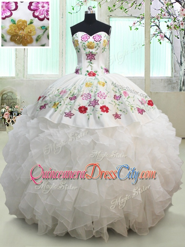 white quinceanera dress with colorful Embroidery and ruffles