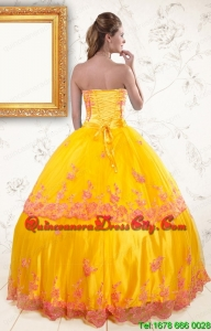 2021 Exquisite Strapless Gold Quinceanera Dresses with Appliques