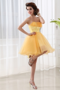 A-line Strapless Organza Gold Mini-length Dama Dress for Quinceaneras with Ruching
