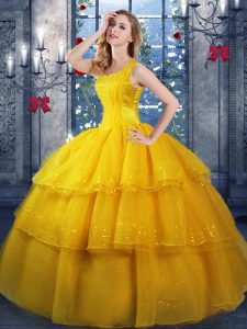 Beautiful Straps Sleeveless Quinceanera Gown Floor Length Ruffled Layers Gold Organza